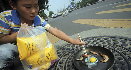China heat wave: It's so hot, manhole covers cook food