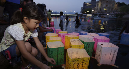 Hiroshima marks atom-bomb anniversary as Japan unveils warship (+video)