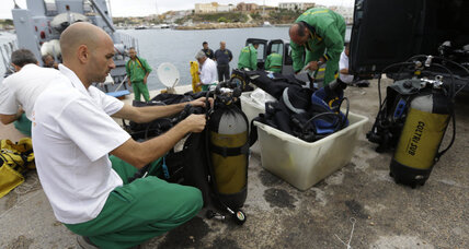 Divers recover more migrants' bodies in Mediterranean