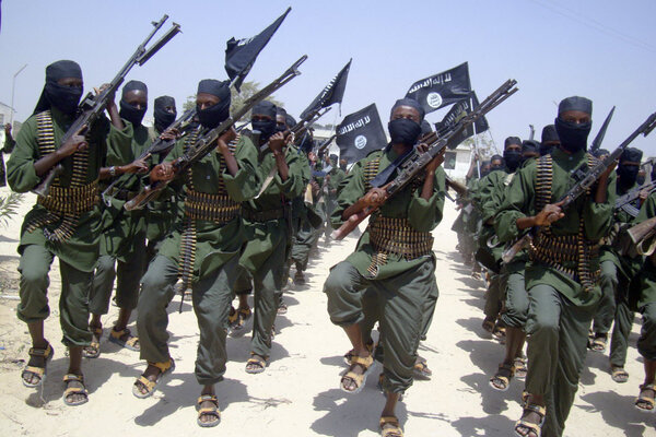 Al Shabab fighters march with their weapons during military exercises on the outskirts of Mogadishu, Somalia in February 2011.