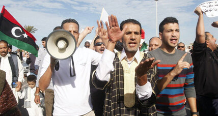 Libyan government struggles for control after militia attack on protesters