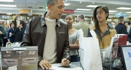 Like millions of holiday shoppers, President Obama does his bit for the economy