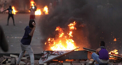 Young boy killed as Morsi supporters and opponents clash in Egypt