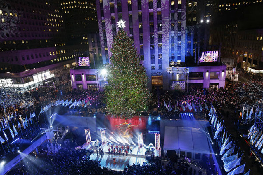 rockefeller center christmas tree lighting dazzles millions