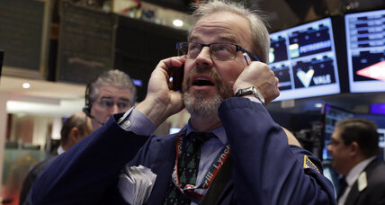 After Fed tapers, stocks hit new record