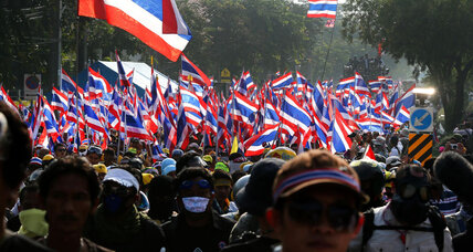 Thai protesters call for a 'people's revolution' as PM sets snap elections