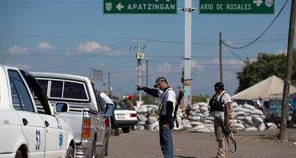Anti-cartel vigilantes and government forces clash in Mexico