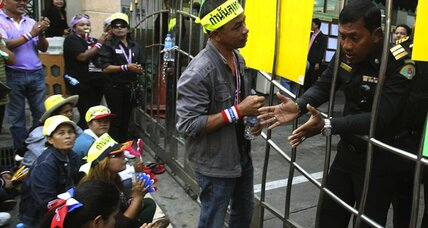 Defying emergency rule, Thai protesters padlock polling stations in Bangkok