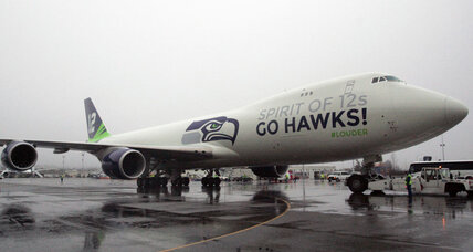 Seahawks 747 flies number 12 pattern over Washington state