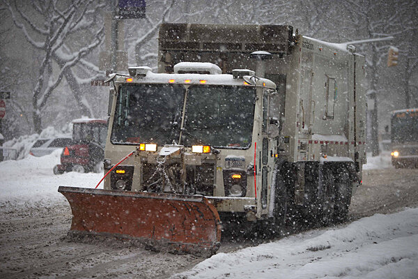 A Garbage Truck Plows Along 5th Avenue At Central Park As It Snows In New York Thursday Winter Storm Moved North The East Coast Of US On