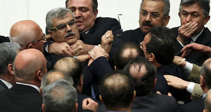 Turkey's parliament brawls, passes law to rein in courts