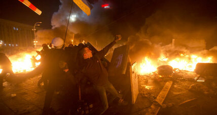 Ukraine protesters clash with government forces amid fires and rubber bullets