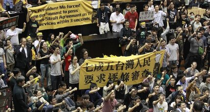 Protesters occupy Taiwan parliament over China trade pact