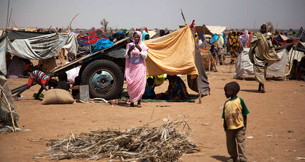 Janjaweed in Darfur burn, loot refugee camp next to UN peacekeeper compound