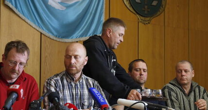 Pro-Russian militiamen parade captured European observers in Ukraine
