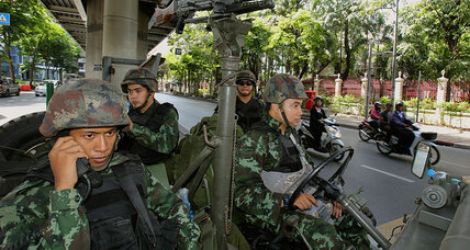 Army takes charge of divided Thailand as critics decry a silent coup