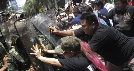 Thailand army tightens grip, threatening protesters with military court