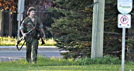 Justin Bourque, man suspected of Canada police shootings, in custody