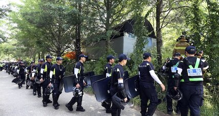 South Korean police raid church compound in hunt for ferry owner