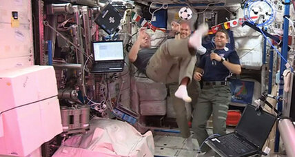 Space station astronaut marks World Cup with zero-g bicycle kicks