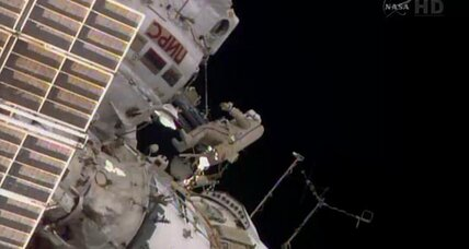Russian astronauts step outside space station