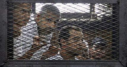 Egypt tightens muzzle on media, sentences Al Jazeera reporters to prison