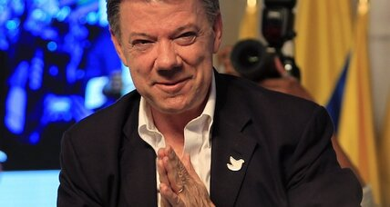 After tight reelection, Colombia's President Santos is told to listen