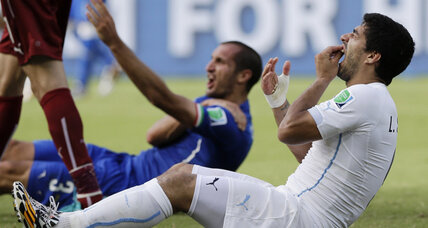 Uruguay's Luis Suarez banned nine games by FIFA for biting World Cup opponent