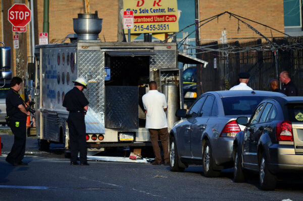 The Philadelphia Police And Fire Department Investigate Scene Of A Food Truck Explosion In Northeast Section On Tuesday