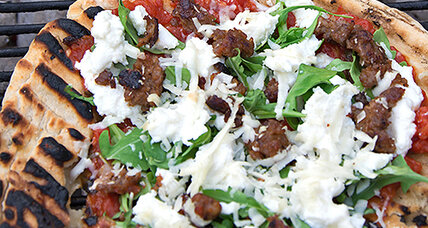 There's a pizzeria in your yard: Grilled pizza with red sauce, sausage, and arugula