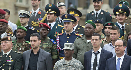 Algerian vets join France's Bastille Day parade, pricking old wounds