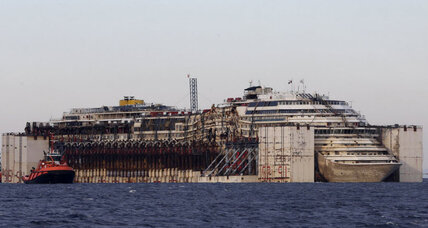 Costa Concordia's last waltz: wrecked liner reaches Genoa port