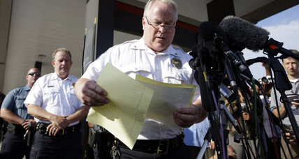 Ferguson officer named in Mike Brown shooting; police cite robbery