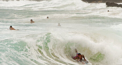 As storm passes over Hawaii, surfers play