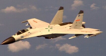 China dismisses US complaints about jet fighter intercept