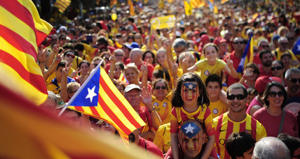 Catalans protest to demand succession vote, boosted by Scotland referendum