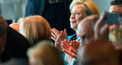 Hillary Clinton returns to Iowa. Is that Joe Biden behind her?