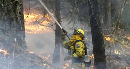 Calif. wildfire growth slows, man faces arson charges