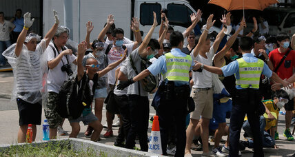 How Ferguson's 'hands up' protest spread to Hong Kong ... sort of (+video)