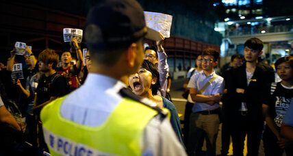 Video of Hong Kong police beating riles protest movement