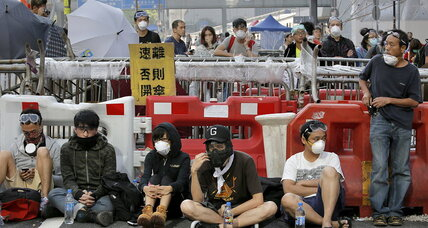 Clashes at Hong Kong pro-democracy protests after police barricades removed