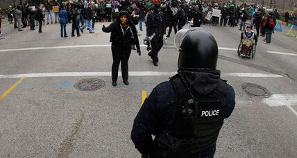 Protested and provoked, police show restraint in Ferguson