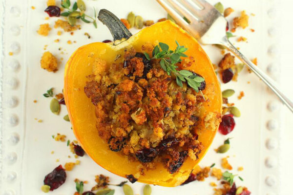 Baked stuffed acorn squash with cornbread stuffing is a delicious side ...
