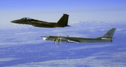 What is Vladimir Putin up to sending Russian bombers close to the US?