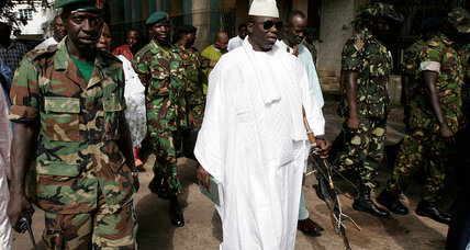 Gunfire reported in Gambian capital as president away, raising specter of coup