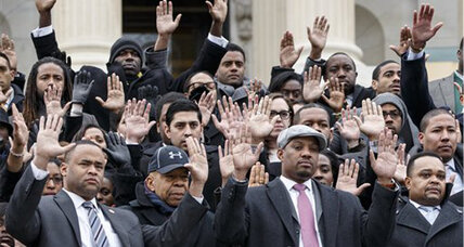 US Capitol staffers – and a few Congressmen – raise their hands for Ferguson