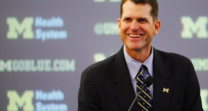 Jim Harbaugh hired as Michigan football coach