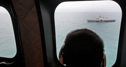 Indonesia expands search for AirAsia wreckage amid rough seas, bad weather