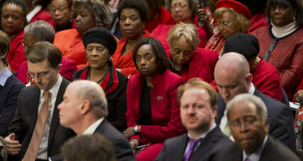 Loretta Lynch hearing: Why all those red suits in the crowd? (+video)