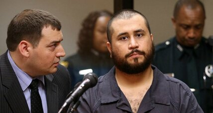 Gun 'hero' George Zimmerman ordered to surrender arms after assault